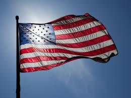 United States flag backlit by the sun